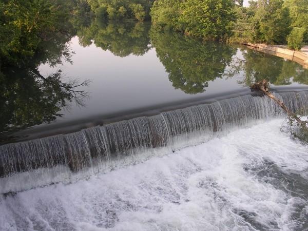 Gorgeous view of the waterfalls at Riverdale Bridge in Nixa
