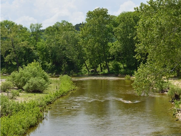 Crystal clear waters of Swan Creek make it a favorite place for swimming/canoeing, kayaking
