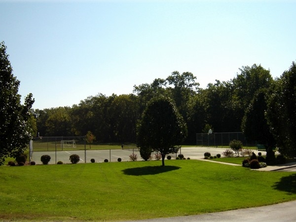Tennis courts are just one of the amenities in the gated community of Stone Meadow