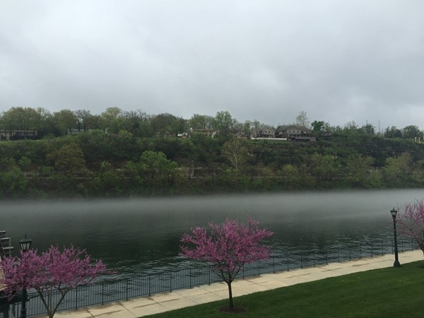 Lake Taneycomo fog in the evening. View from Branson Landing