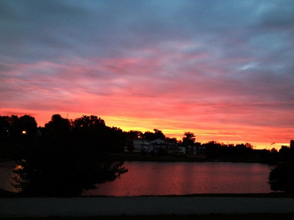 Beautiful sunrise over McKay Lake in Jefferson City! Great location for fishing, walking, and fun