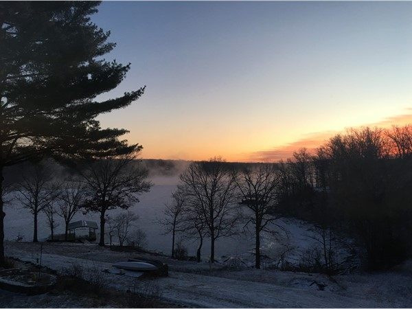 Frigid temperatures have the lake frozen at the 77mm of the Lake of the Ozarks at sunrise