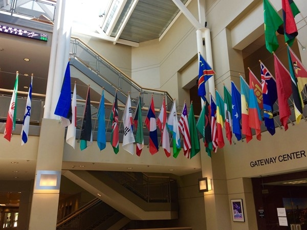 UCM Admin Bldg: flags for students around the world who have attended this outstanding university
