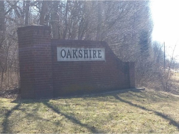 Entrance to Oakshire! Paved road country living with easy access to 50 Hwy