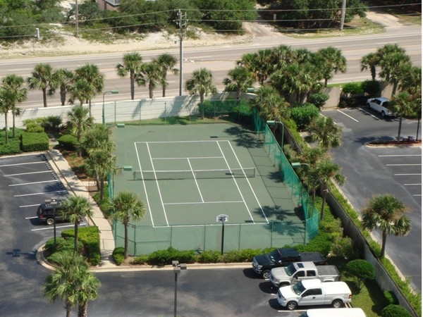 Play a game of tennis or basketball while staying at Pelican Pointe in Orange Beach