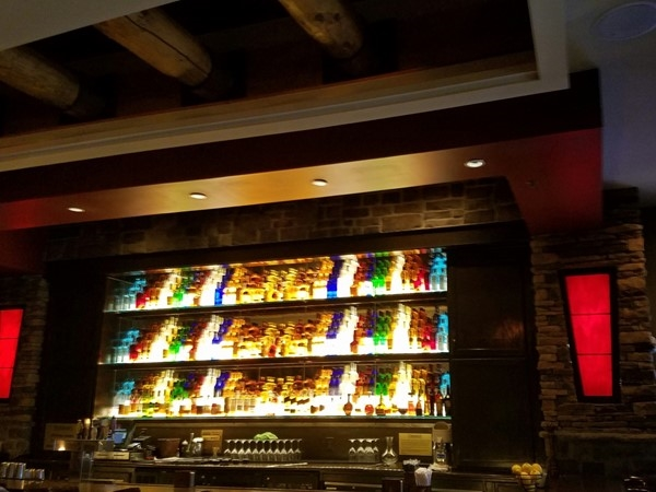 Firebirds Wood Fired Grill...rustic stone interior with a colorful bar