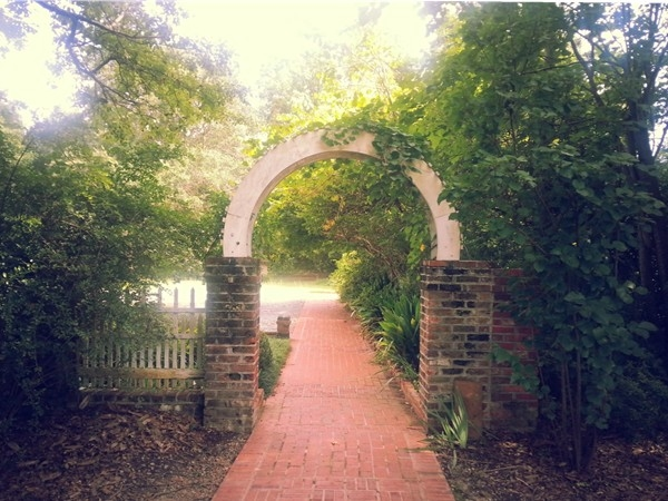 An arched entrance on the grounds of Grace Episcopal Church. A historic landmark in Pike Road