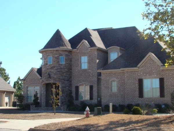 Turtle Creek homes are all custom!  Look at this lovely stacked stone tower!
