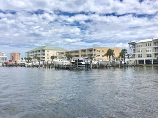 A boat view of six condominiums from Perdido Bay