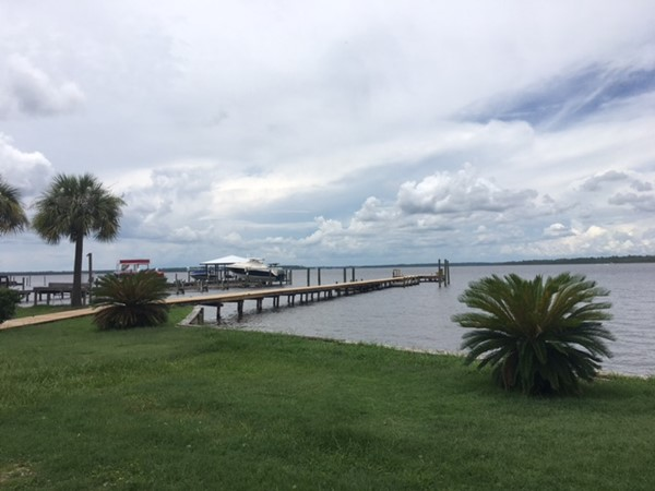 A pier overlooking Little River in Orange Beach
