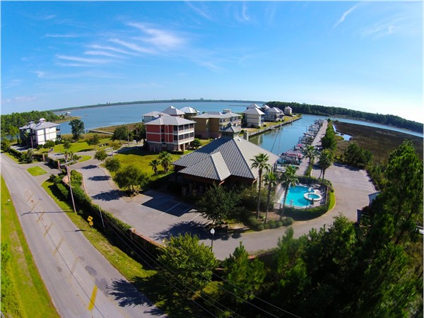 Aerial view of the clubhouse, pool and marina in gated Sunset Bay at Bon Secour!