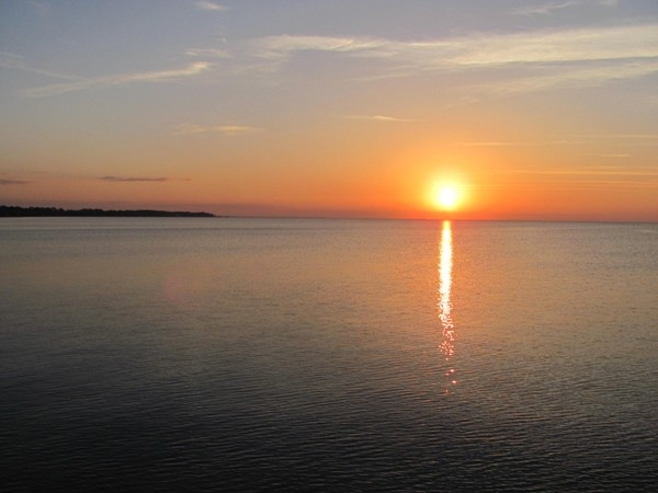 Enjoy a beautiful sunset from the pier over Mobile Bay at The Peninsula