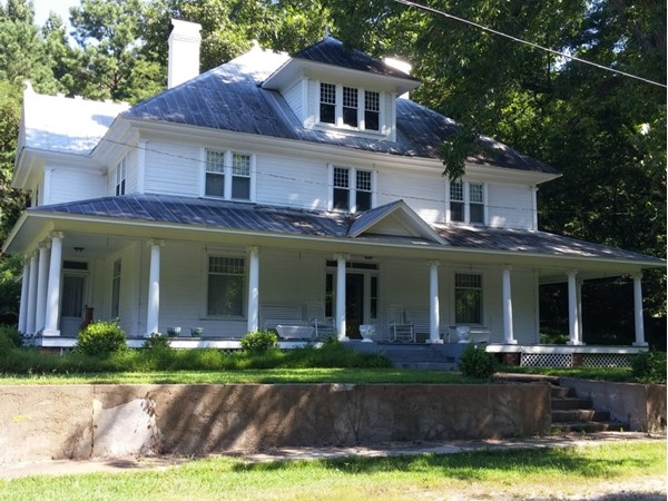What a grand old home. The rockers on the front porch look mighty inviting!