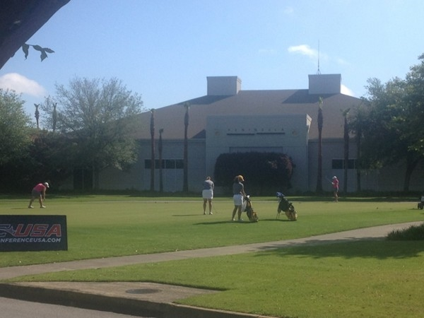 Ladies warming up for Conference USA Women's Golf Championship at The Peninsula