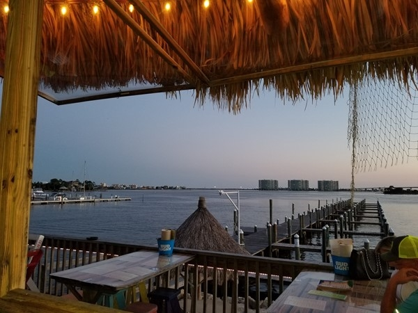 Always a view! The Caribe Resort (three towers) across the water from the Pleasure Island Tiki Bar!