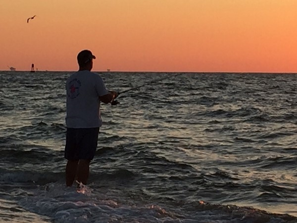Fun fishing and beautiful sunsets at the tip of Fort Morgan