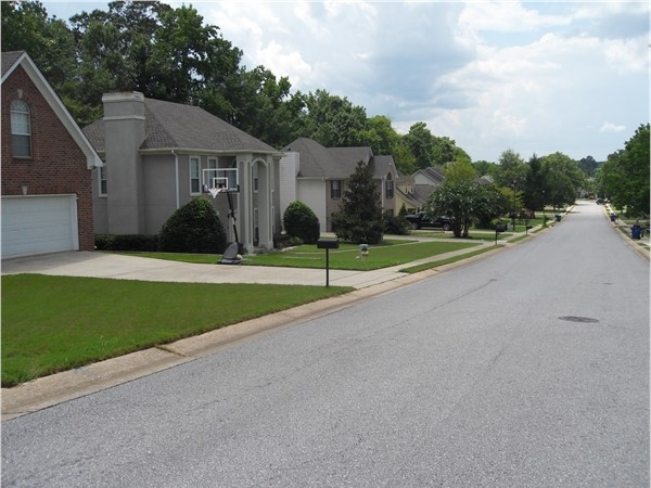 Street view of Amberely Woods - beautifully maintained lawns throughout