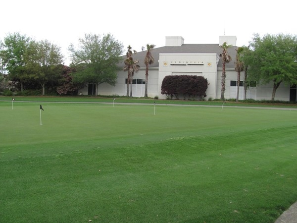 Enjoy the practice putting green at The Peninsula Golf Course.