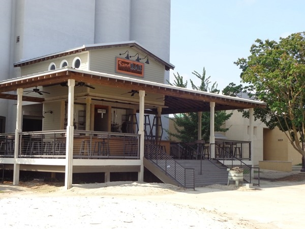 Sand Bar! Great spot to enjoy a drink, play corn hole, and listen to live music