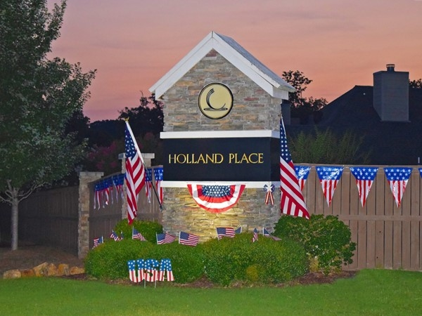 The residents of Holland Lakes & Holland Place deck out the entrance for the 4th of July