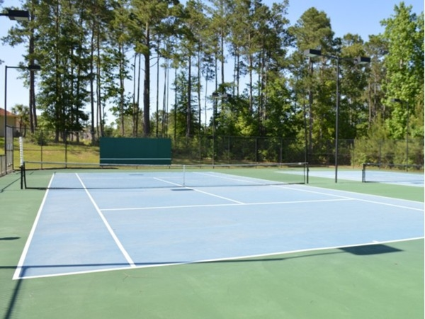 Lighted tennis courts are one of the many wonderful features of the Stillwater neighborhood