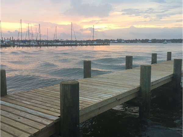 Sunset over the sailboats in Bear Point Marina in Orange Beach