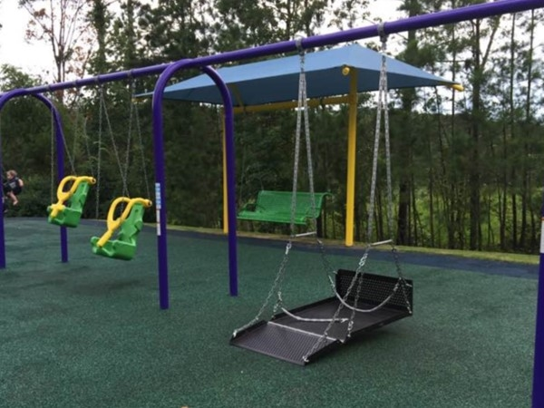 Wheelchair swings and adaptive swings at Miracle League Park