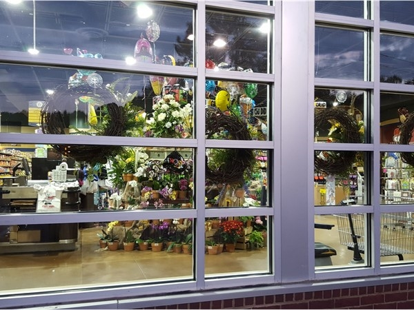 Looking in the window at flowers in Piggly Wiggly