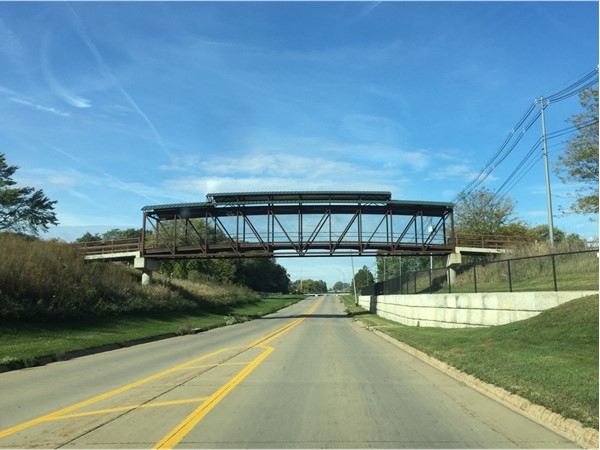 Golf cart bridge spans a busy road at Waverly Municipal Golf Course