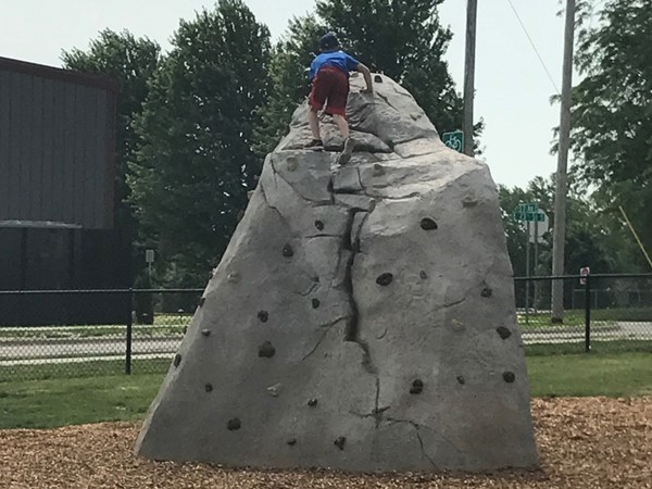 Climb the rock and lots more fun at Aurora Park located at 111 1st Ave E, Newton