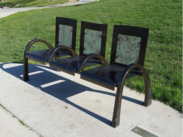 """This bench, called Reflection, is part of the """"Take A Seat"""" exhibit in downtown Omaha"""