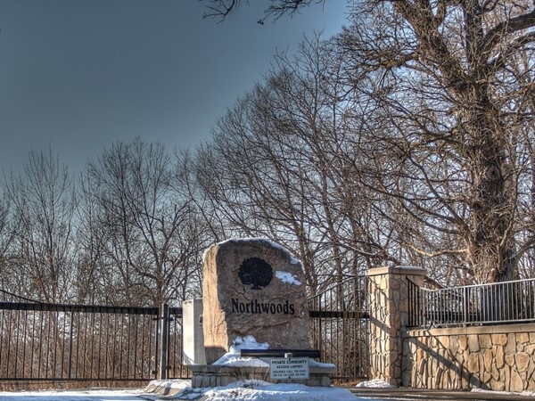 Picturesque entrance in the gated community of Northwoods