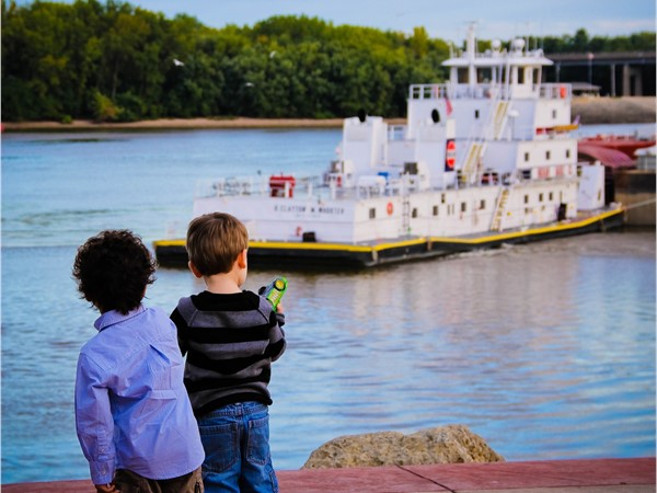 Children love watching the barges go by while walking along the riverfront