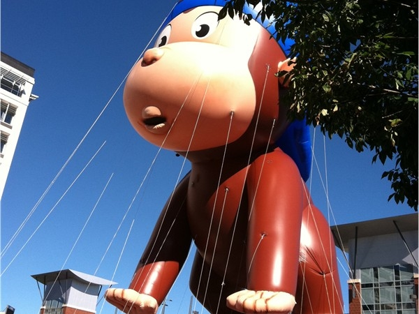 """""""Curious George"""" at the Septemberfest Parade in downtown Omaha"""