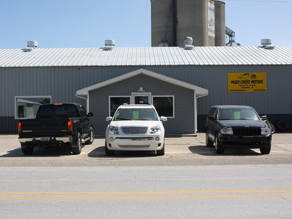 Mudd Creek Motors. They sell used cars, tires and are a full service garage