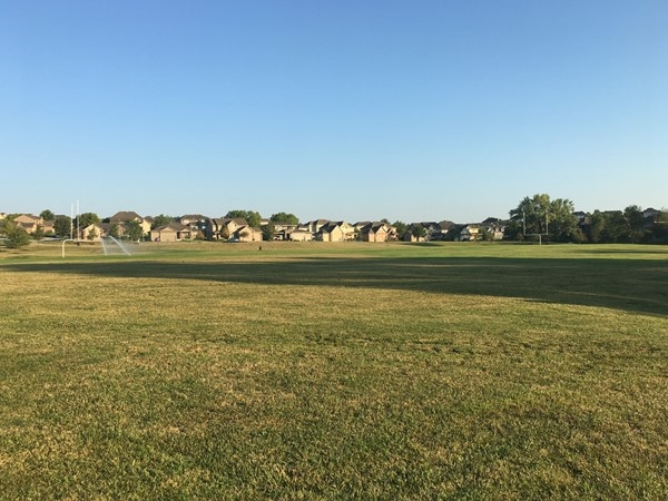 View of football field and Copperfields homes in the background from Copperfields Park