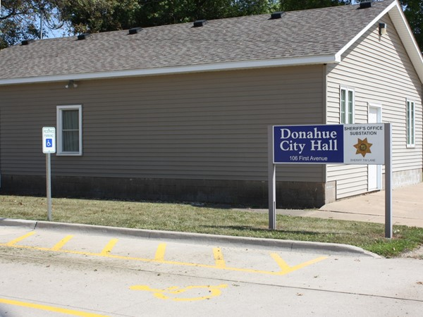 Donahue City Hall is located right next door to First Trust and Savings Bank on 1st Ave