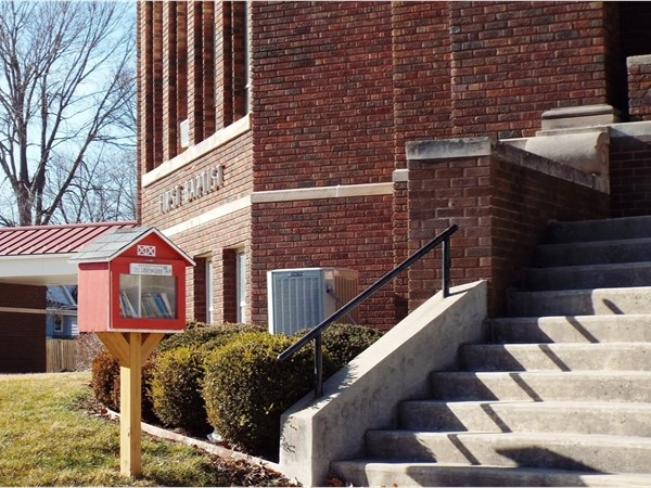 """Red school house """"Little Free Library"""" spotted in front of First Baptist Church on W 5th in Waterloo"""