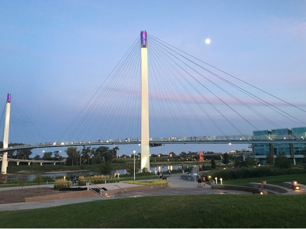 View of the park at night under the Bob Kerrey Pedestrian Bridge connecting Nebraska and Iowa