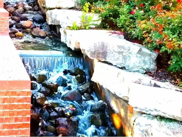 A peaceful stream inside of the Conagra Foods Garden