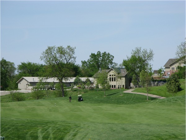 The 18th fairway, hole is to the left over the creek. Pool house, workout center and clubhouse