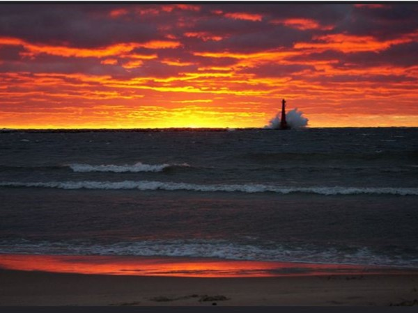 Pere Marquette Beach is a great place to catch the spectacular sunsets over Lake Michigan