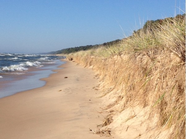 Hike the trail at PJ Hoffmaster Park or camp and enjoy the dunes even longer