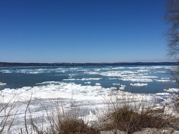 A view of beautiful East Grand Traverse Bay as the clear blue sky is reflected in the water