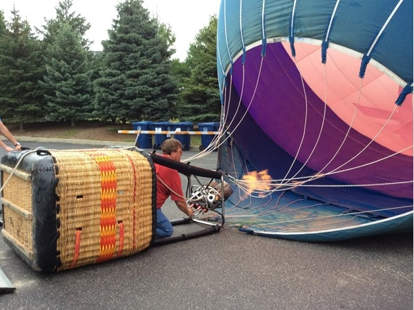 RE/MAX balloonist inflating balloon for Maytag Ironman event