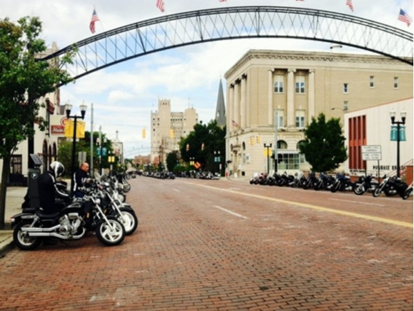 Bikes line up along the famous brick street during Bikes on the Bricks