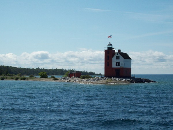 Round Island Light House hugs the shore of Mackinac Island