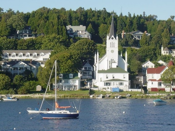 A boat deck view of the historic buildings of Mackinac Island