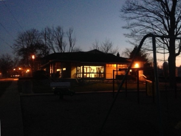 Although it is getting dark earlier, the lights are still on at the public library in Coopersville