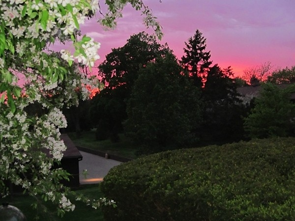 A pink sunset from my own balcony at Earhart Village Condominium Homes